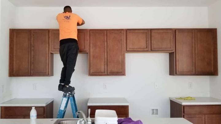 builder installing kitchen cabinets (low cost) that came free with the house