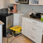 How to Dry Out Kitchen Cabinets