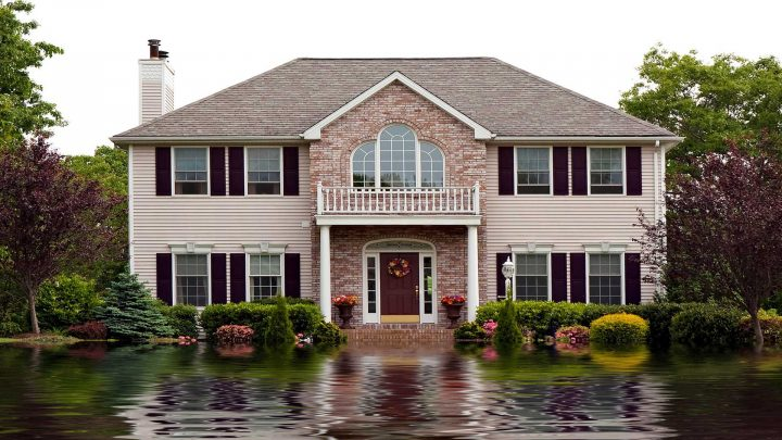 house surrounded by water is a good indicator that you need flood insurance