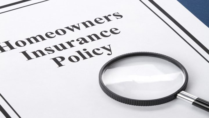 magnifying glass looking at homeower insurance policy to encourage you to get the right policy when buying homeowner insurance