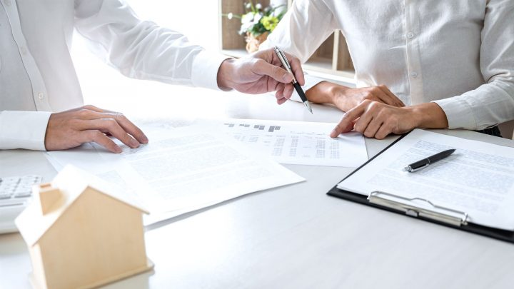 insurance agent explaining details to homeowners ... with caution that soe insurance agents are great but hard to find, so do your homework before buying your homeowners policy